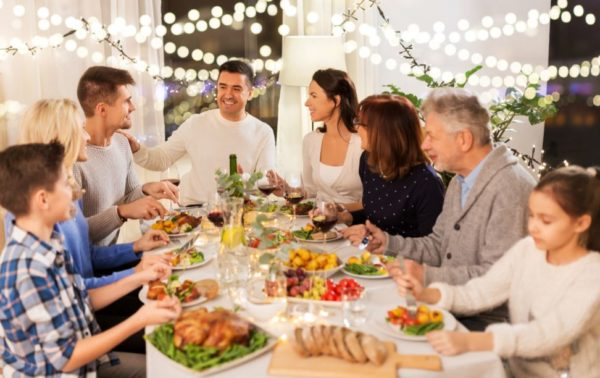 Family sitting around table having a holiday dinner