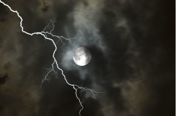 Lightning strike on cloudy night with full moon