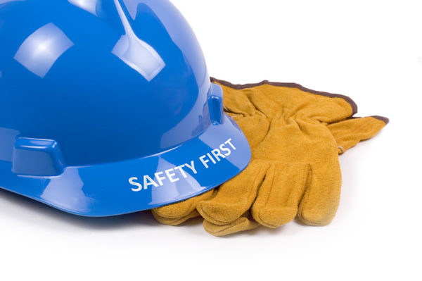 Safety first hard hat and work gloves
