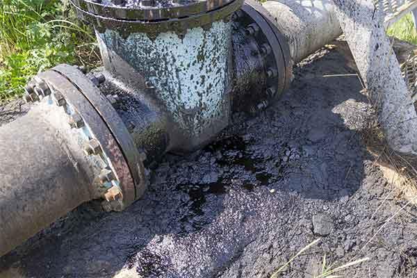 Pipe Leaking Oil Into Soil